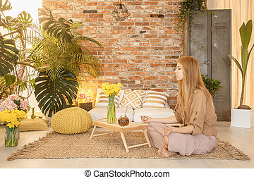 Girl meditating in room