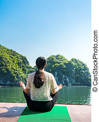 Girl meditating on a cruise boat