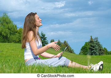 Girl memorising something on her tablet