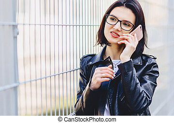 Girl messaging on phone and smiling