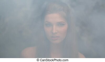 girl model smoke blowing smoke biting her lip