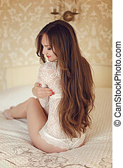 Girl model with long brown hair style wearing in white lace...