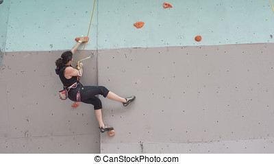 girl mountaineer with climbing equipments. young athletic...