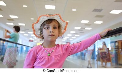 Girl moving on speedwalk at airport