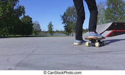 Girl moving with leg skateboard