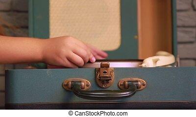 Girl music sets record - a little girl sets a vinyl music...