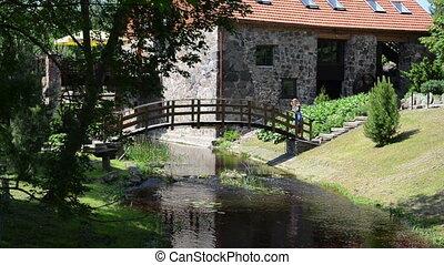 girl narrow bridge - young girl goes a narrow wooden bridge...