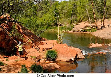 Girl near a Creek