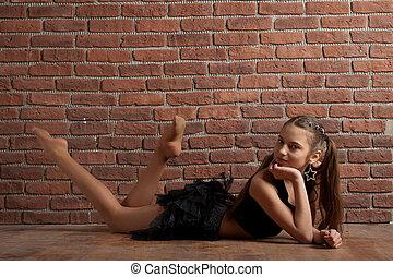 Girl near brick wall