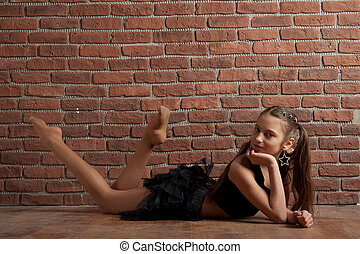 Girl near brick wall