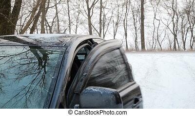 Girl near the car in winter