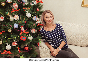 girl near the Christmas tree in a house interior