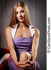 Girl near the piano
