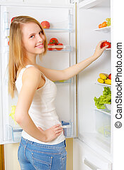 girl near the refrigerator