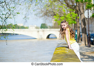 Girl near the Seine on a summer day