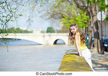 Girl near the Seine on a summer day