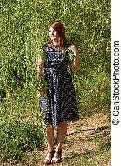 Girl near willow tree