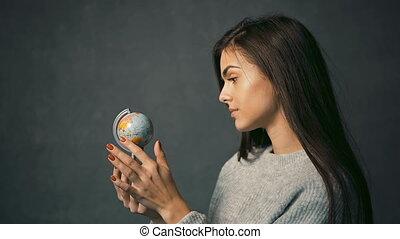 Girl Observes the Globe