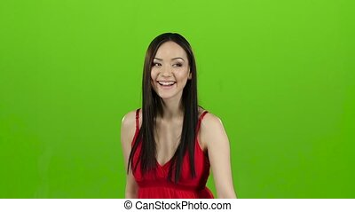 Girl of Asian appearance goes shopping, with paper. Green screen. Slow motion