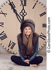 girl on a background of huge clock - beautiful girl on...
