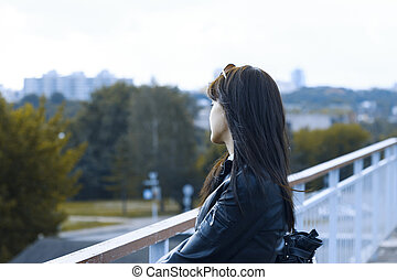 Girl on a background of the city