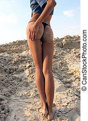 girl on a beach - Female legs on a be