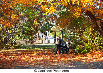 girl on a bench in park