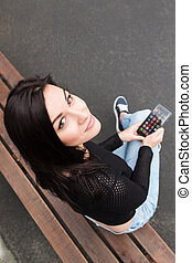Girl on a bench with your phone