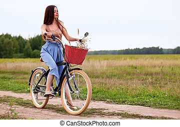 Girl on a bike in the countryside
