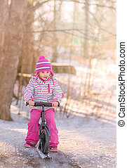 Girl on a bikesled in winter