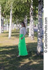 Girl on a birch avenue