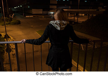 Girl on a bridge before suicide