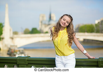 Girl on a bridge in Paris