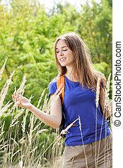 Girl on a field of wheat