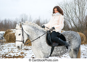 Girl on a horse.