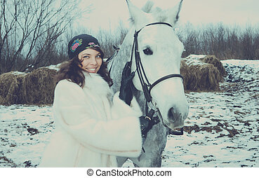 Girl on a horse. winter