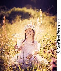 Girl on a meadow in the summer.