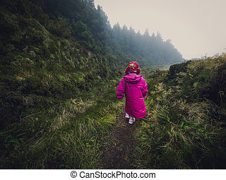 Girl on a mountain trail