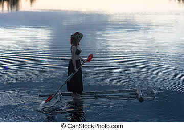 girl on a raft in the night