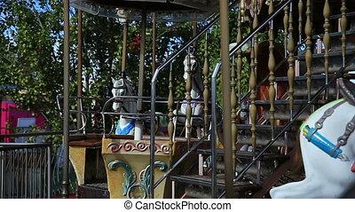Girl on a retro style merry go round. Carousel.