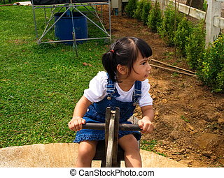 Girl on a seesaw