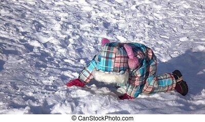 Girl on a snow slide