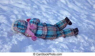 Girl on a snow slide