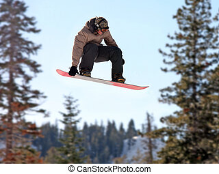 Girl on a snowboard - Teen girl jumping high on a snowboard