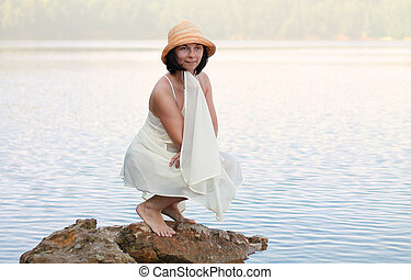 Girl on a stone