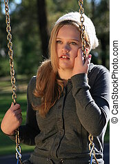 Girl On A Swing - Close Up Portrait