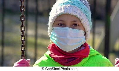 Girl on a walk near the house during the quarantine period ...