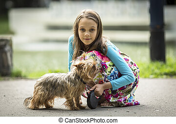 Girl on a walk with her little dog.