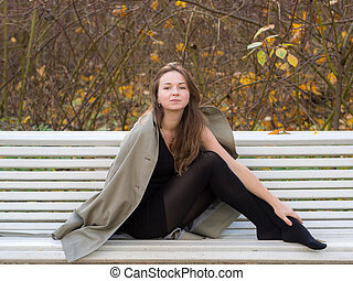 girl on a white bench