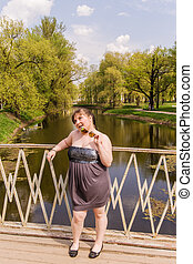 Girl on a wooden bridge